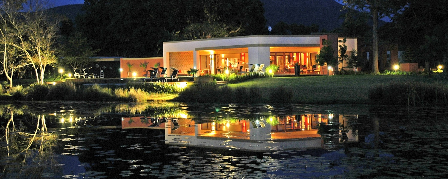 Restaurant and pond by night
